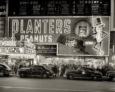 "New York circa 1947. ""National Peanut Corp. store on Broadway -- Mr. Peanut sign and Embassy Newsreel Theatre."" 4x5 negative by John M. Fox."