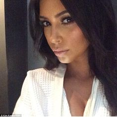 'It was my hair oil!' Kim Kardashian reveals she doused herself in Black Seed Dry Oil from her haircare range for THAT full frontal photoshoot... as she poses for a selfie
