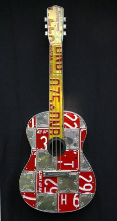 guitar made from tin ceiling tiles and license plates