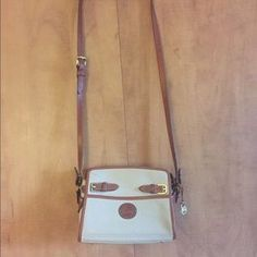 I just discovered this while shopping on Poshmark: Vintage Dooney & Bourke Purse in Ivory. Check it out!  Size: One Size