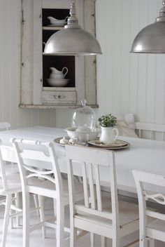 Kitchen/Breakfast Dining...  Love the matching but mis-matched chairs and table... love the pendants!