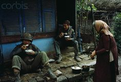 https://flic.kr/p/6F2KXd | U.S Marines eat a bowl of rice during battle in Hue | 13 Feb 1968, Hue, South Vietnam --- U.S Marines eat a bowl of rice which was served to them by a South Vietnamese woman. --- Image by © Bettmann/CORBIS
