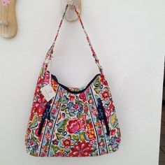 "Vera Bradley handbag--Never used! Never used with tag--a few seasons old. Vera Bradley ""Hope Grows"" purse. 2 zip pockets on front; 2 slide pockets on inside; zipper close on top; comfortably fits on your shoulder Vera Bradley Bags"