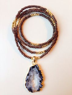 Agate Druzy Slice Pendent with Gold Edging, suspended on a Dark Wood Bead Strand with Genuine Gold Pyrite Bead Accents
