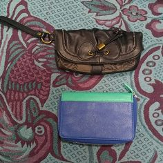 Passport wallet and Nica Clutch I am selling two wallets together. The blue wallet holds a passport and has a sleeve for a phone or small notebook. I've never used this. The black clutch has probably been used a few times but I'm not sure. I am looking to downsize my things. They come from a smoke free home. I am will accept a reasonable offer. Nica Bags