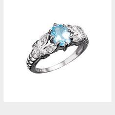 Sterling Silver Genuine Blue Topaz Ring Avon ring size 7. Great condition never worn Avon Jewelry Rings