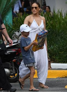 Summer ensemble: The Ain't Your Mama singer was comfortable in a loose-fitting, white jump...
