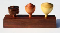 Sparcist Single wood tops in stand.