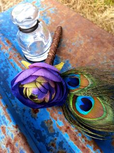 Very close to what Im looking for in a bouquet. Feathers, purple, (less yellow) and add some blue.