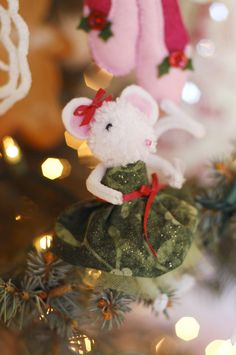 Pompom Mouse Christmas Ornament - no tutorial, but these look like the ones from the Martha Stewart website. Click to see more cute examples from The Christmas Cottage on TikkiDo.com
