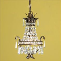 """Mini Crystal Basket Chandelier  This mini chandelier was inspired by a French antique and truly has you guessing if it is the real thing. The petite size is perfect for lower ceilings, over exquisite kitchen island, or tight spaces like powder rooms or hallways. The aged Bronze finish has authentic appeal. The perfect mini crystal basket chandelier.   100 watts. (medium base socket)   (15.5""""Hx16""""W)   5"""" canopy   6' chain   Product SKU: CH11068 BZ  Price:  $289.00"""