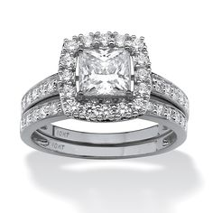 So sophisticated, so sparkly, so affordable. 1.93 carats T.W. of fiery cubic zirconia make this halo wedding ring set sPrice - $230-ui36HPQ2