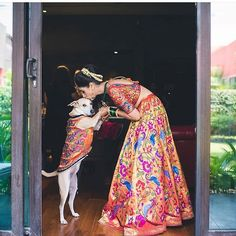 """Such a beautiful shot! A picture perfect moment capturing the love between @mitalisalvi and 'Pantu wearing the same outfits.  Photo by @weddingnama Lehnga by @sakinashakeer  #Eventmasons #Weddingphotography #Photooftheday #Instabride #Bridalwear #Ootd #Yoursinweddings #Love #Instaweddings #Fun #Indianbride #Instamood #Weddings #Bride #Weddingphotographer #Bridalmakeup #Igers #Doglove"" by @eventmasons. #eventplanner #weddingdesign #невеста #brides #свадьба #junebugweddings #greenweddingshoes…"