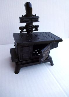 Cooking with magick - VINTAGE - Miniature Cast Iron Stove - perfect size for the wee folks.. 24.95, via Etsy.