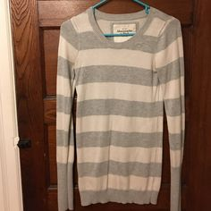 Abercrombie and Fitch long stripped sweater Abercrombie and Fitch long grey stripped sweater. Tag says large but it fits like a small. Long enough to wear with leggings. Embroidered moose on the chest. Very cute and comfy. Great with leggings and boots! Abercrombie & Fitch Sweaters Crew & Scoop Necks