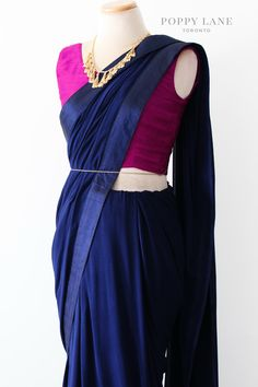 This simple saree is perfect for any occasion. Silky georgette with a raw silk trim. Shop now at poppylane.ca