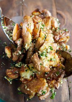 smashed potatoes tossed in garlic, lemon zest, parsley, parmesan