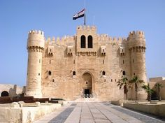http://www.TravelPod.com - Alex Castle by TravelPod member Mikeandfi, from Alexandria, Egypt ... Built on top of the famous lighthouse of Alexandria. Parts of the original Lighthouse can be see in the walls and lintels in this chocolate box castle. One of the best looking castles and possibly the worst castle defensively as everyone who has used it has lost. Maybe that's why it is still so pretty.