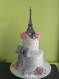 JAH LIKES THIS CAKE DESIGN...Parisian inspired cake...changE pink for sky blue/silver...maybe sparking glitter type ribbon...tying in 'A Night In Paris' theme...detail is nice on this.