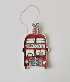 A little personalised double decker bus with parcels aloft, is off to the North Pole! Little red bus is created using wool cream, glitter cloth, cotton cloth, linen thread and free hand machine embroidery. The buses red colour is built up with lo. Christmas Sewing Projects, Christmas Time, Christmas Ornaments, Red Bus, North Pole, Cute Crafts, Little Red, Textile Art, Machine Embroidery