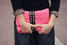 studded pink clutch