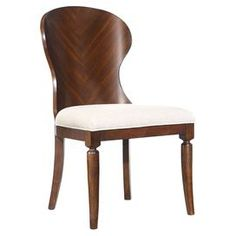 "Bring a touch of refined elegance to your dining table or living room seating group with this handsome wood side chair, showcasing a gently curved silhouette and cream-hued upholstered seat.  Product: ChairConstruction Material: Hardwood solids and walnut veneersColor: Brown and creamFeatures: Curved silhouetteDimensions: 39.75"" H x 19.5"" W x 24.25"" D"
