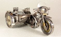 Miniature motorcycles from old watch parts.