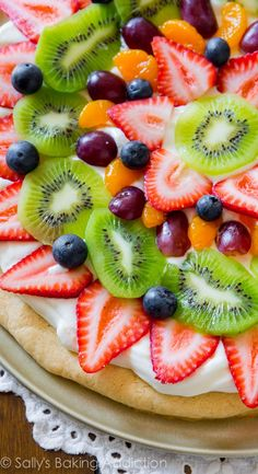 Classic colorful fruit pizza on a soft sugar cookie crust and topped with creamy, thick cream cheese frosting.