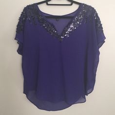 Brand new Express blue silk blouse Blue silk blouse with dark blue sequins. Never worn. In perfect condition. Express Tops Blouses