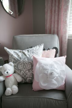 Afeminine, romantic nursery inshades of soft pink, gray, and white with crystal accents, and vintage inspired accessories