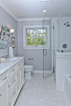 """Traditional Full Bathroom with Subway 6"""" x 3"""" Tile in Bright White by Giorbello, Rain shower, Crown molding, Wall sconce"""