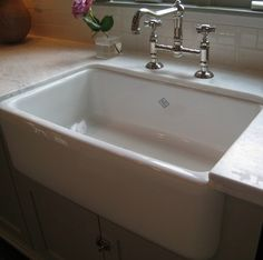 Love the sink and bridge faucet