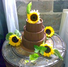 Sunflower and chocolate curl wedding cake Chocolate Curls, Tasty Chocolate Cake, Polhawn Fort, 50th, Wedding Cakes, Weddings, Table, Beautiful, Wedding Pie Table