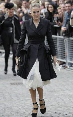 At the funeral of her friend Lee McQueen, Parker chose a fitted black jacket and a cream dress by the designer, teamed with black platforms and a tight bun, capturing the drama of the occasion perfectly