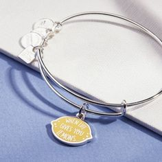 The lemon possesses a fresh citrus flavor and cheerful color. Cleansing, the lemon symbolizes the chance to make a change. When life gives you lemons, you have the power to take positive action, sweeten the situation, and make lemonade. The power to creat Alex And Ani Bangles, Wedding Bracelet, Jewellery Display, Bracelet Designs, Bangle Bracelets, Jewelry Necklaces, Jewelry Collection, Bling, Charmed