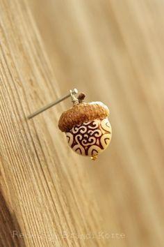 Acorn bead charm.  or wood burn a design in an acorn.
