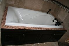 Don't forget about that tub.  Incorporate cabinet style on your built-in tub front [Copper River Cabinet Company]