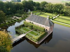 The Groningen estate house with its boulevards, gardens and moats is the very centre of the country estate. After various renovations, the current building can be compared to the longhouse from the fifteenth and sixteenth century. Small Castles, Unusual Homes, Country Estate, Aerial Photography, Farm Life, Travel Around, Landscape Design, Netherlands, Mansions