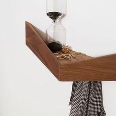 Pelican walnut wall hung shelf by Spanish label Woodendot.  44 cm wide X 15 cm deep X 10 cm high.