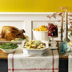 What a beautiful Thanksgiving buffet presentation! More entertaining ideas: http://www.bhg.com/thanksgiving/indoor-decorating/easy-centerpieces-for-thanksgiving/?socsrc=bhgpin102212thanksgivingdinnertable