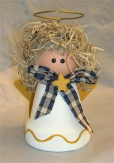 Craft an easy clay pot angel for Christmas. Visit FreeCraftz for even more Christmas crafts and angel crafts. Christmas Angel Crafts, Christmas Projects, Kids Christmas, Holiday Crafts, Christmas Clay, Clay Pot Projects, Clay Pot Crafts, Diy Clay, Shell Crafts