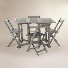 A brilliant outdoor dining solution - especially for small spaces - our versatile dining set features four chairs that fold and nest compactly under the collapsed table for a space-saving storage design. Each piece is crafted of solid acacia wood finished in a graywash and coated with a layer of UV protection.
