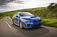 Rally ace Mark Higgins sets new lap record around famous TT circuit in all-new Subaru WRX STI