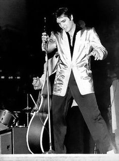 Elvis on stage in Toronto ( Canada ) evening showin april 2 1957  , wearing the top of his legendary gold suit .