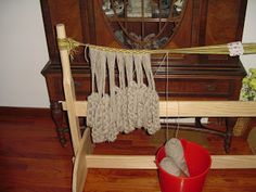 Oseberg loom being used to make a tablet-woven header band