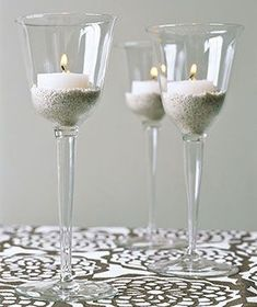Wine Glasses as Candle Holders - Elevate tealights or plain votives. Place a candle in a thick-walled glass and anchor it with a thin layer of sand or small pebbles for more elegant mood lighting.