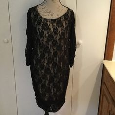 Torrid sexy lace dress Black lace tan lining. See through lace arms long sleeve. 2 black bow ties down back. Scrunched on sides near bottom. torrid Dresses Midi