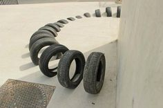 Barcelona artists use old tires as street art to revitalize the city