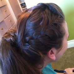 A simple mid pony tail. Then have two French braids on each side that wrap around the ponytail. Then if you have bangs make a little bump at the top. This would be better if my model had shorter bangs to stop it from covering the braid.