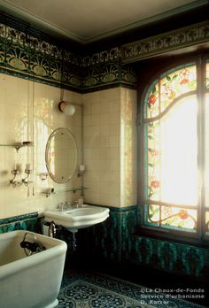 Salle de bains, 1905. French Art Nouveau bathroom. I think the dark frieze and wainscot highlight this room's upscale look.